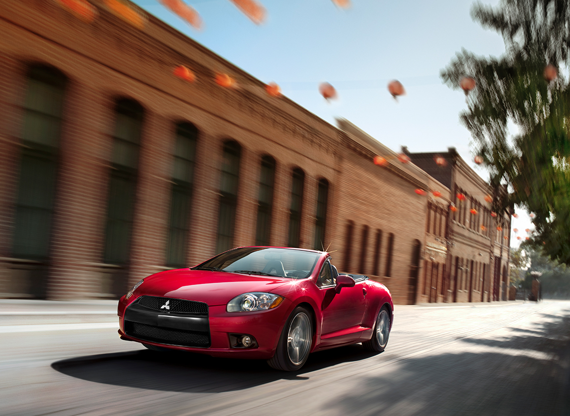 2011 Mitsubishi Eclipse Spyder GS convertible In red driving