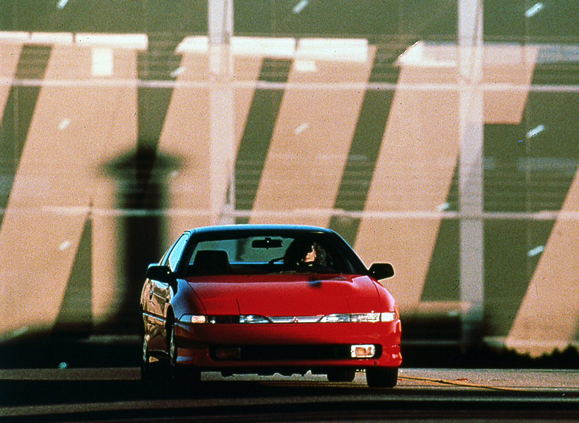 Front view of 1990 Mitsubishi Eclipse GSX in red