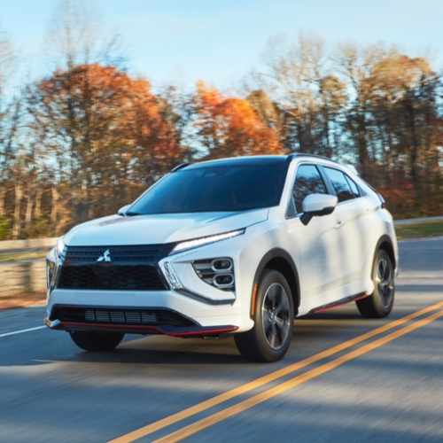 Front and side view of the 2021/2022 Mitsubishi Eclipse Cross on the road