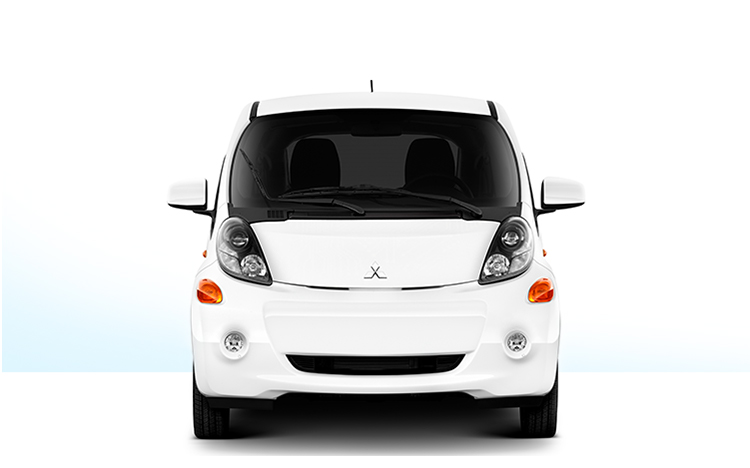 The front of a white Mitsubishi i Miev electric car