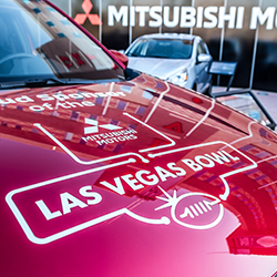 Close up of a Las Vegas Bowl decal on the front hood of Mitsubishi vehicle.