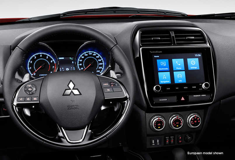Interior of the steering wheel and console of the 2020 Mitsubishi Outlander Sport