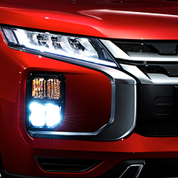 Headlight of a red 2020 Mitsubishi Outlander Sport