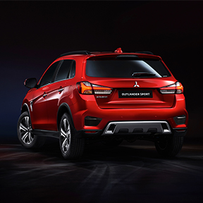 Back profile view of a red 2020 Mitsubishi Outlander Sport