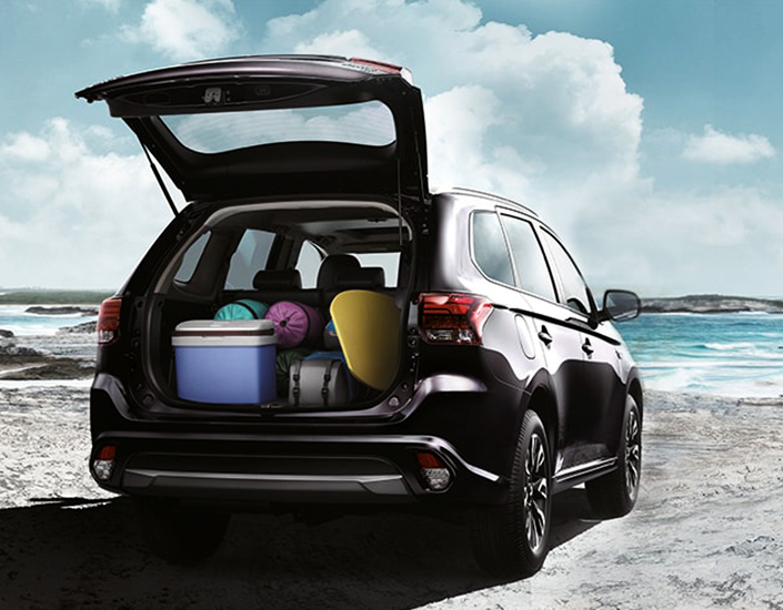 Black tailgate open with cargo in a Mitsubishi Outlander