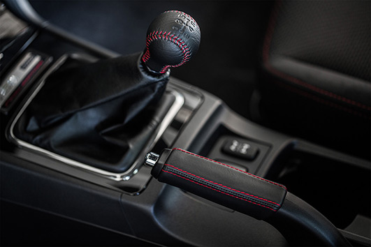 Even the interior of the Evolution FE stands out, with red-stitched, all-black materials.