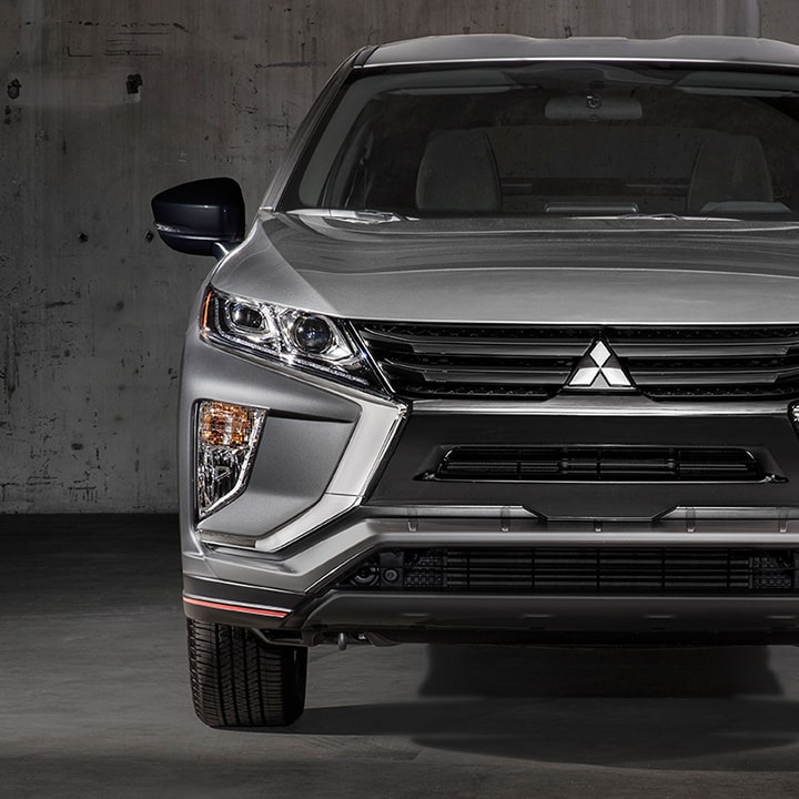 The Eclipse Cross LE leads with an aggressive and sleek black front grille.