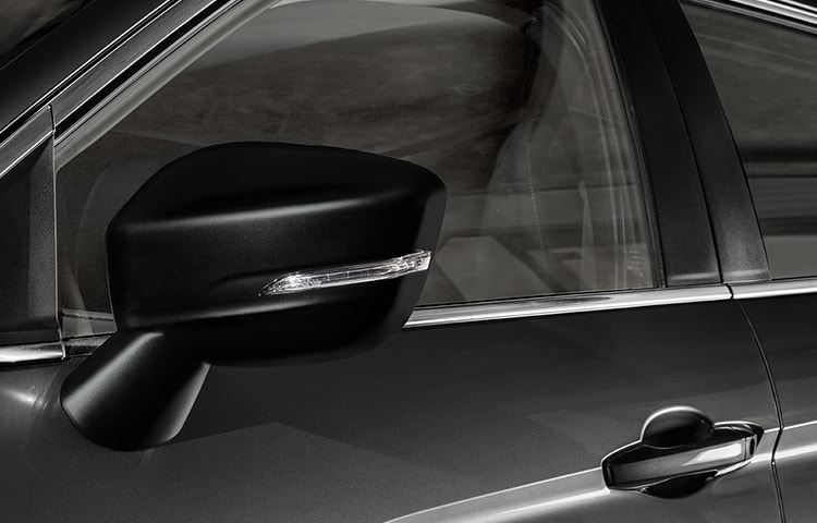 Distinct black side view mirrors offer sleek style while keeping objects in sight.