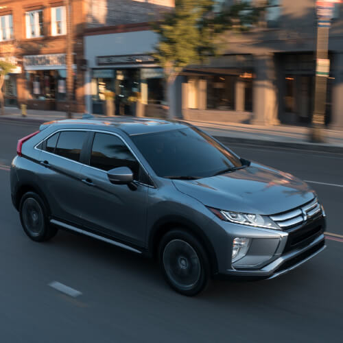 A black Mitsubishi Eclipse Cross driving on urban road