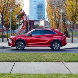 Side Profile of a parked red 2021/2022 Mitsubishi Eclipse Cross crossover