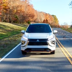 Front view of a white 2021/2022 Mitsubishi Eclipse Cross on the road