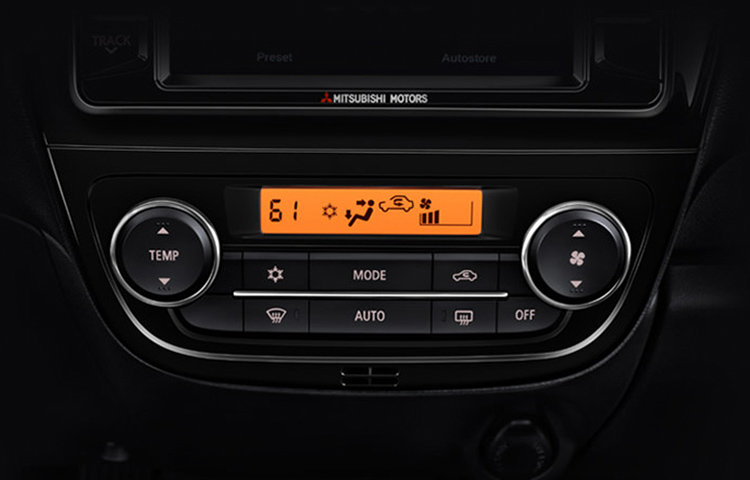 An interior image of the climate control system found in the new 2019 Mitsubishi Mirage G4.