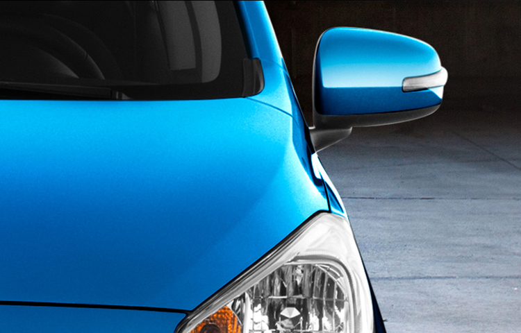 A close shot of the front of a blue 2019 Mitsubishi Mirage G4.