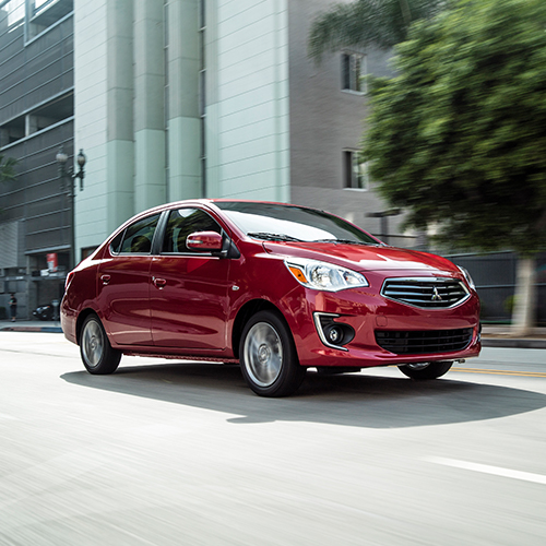 Front side view of a red 2019 Mitsubishi Mirage G4 car.