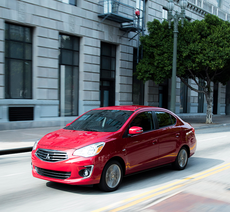 A red 2019 Mitsubishi Mirage G4 driving down the street
