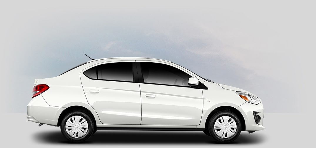 A side view of a pearl-white Mitsubishi Mirage G4.