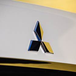 Close up of the Mitsubishi Badge on the back of a white 2020 Mitsubishi Mirage G4.