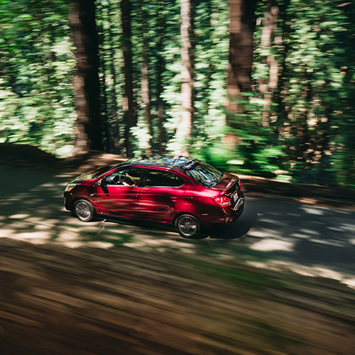 Top view of a red 2020 Mitsubishi Mirage G4 driving in the woods.