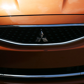 Close up of the front of a 2019 Mitsubishi Mirage car front badge.