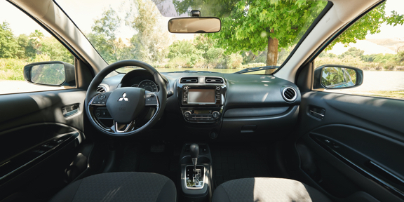 An interior view of the front seat of a 2020 Mitsubishi Mirage.