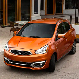 A front overhead view of an orange 2020 Mitsubishi Mirage.