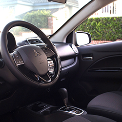 Interior drivers side view inside the 2020 Mitsubishi Mirage compact car.