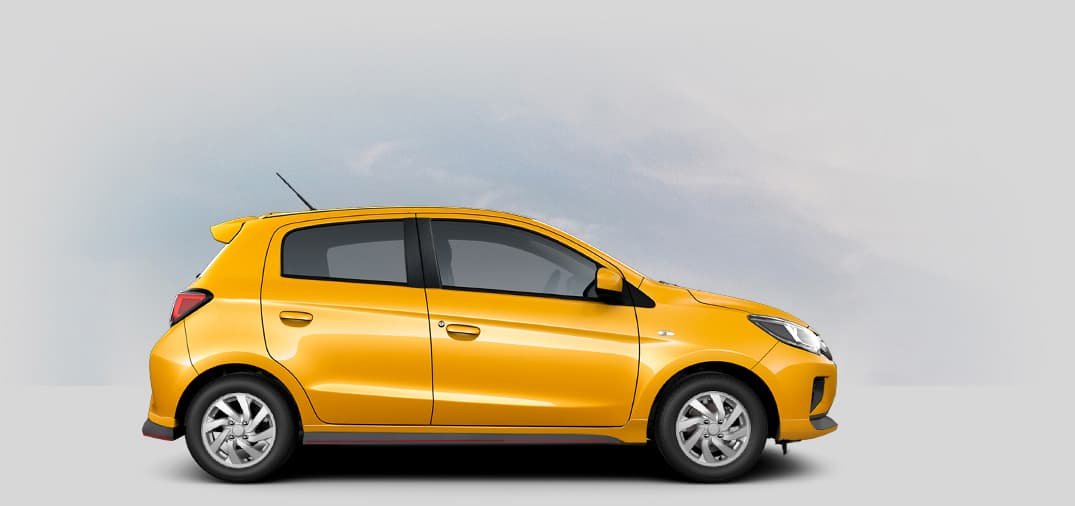 A 2021 Mitsubishi Mirage CARBONITE EDITION with sand yellow color.