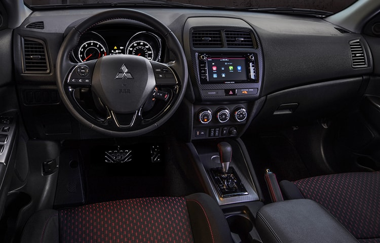 Dramatic red stitching accentuates the premium seating, steering wheel, and shift knob.