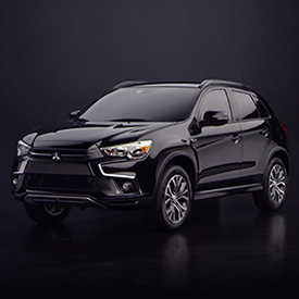 Front side view of a 2019 Mitsubishi Outlander Sport SUV in black.