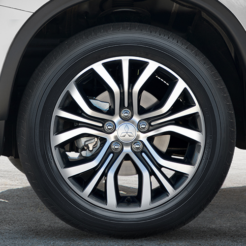 Close up of the two tone alloy wheel on a 2018 Mitsubishi Outlander Sport SUV.
