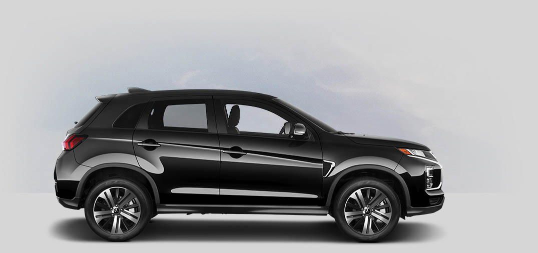 A side view of a labrador black metallic Mitsubishi Outlander Sport.