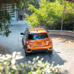 An overhead view showing the roof rack on an orange 2021 Mitsubishi Outlander Sport.