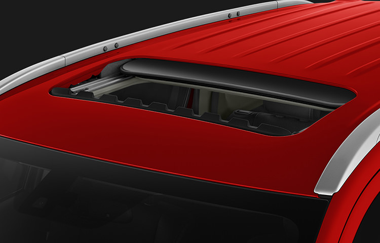 2016 Mitsubishi Outlander exterior view of sunroof in rally red