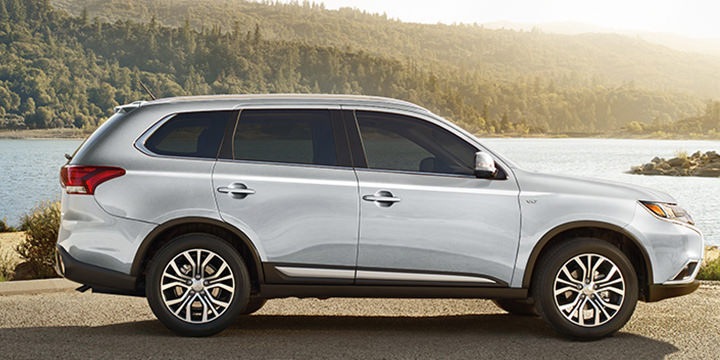2016 Mitsubishi Outlander CUV exterior in cool silver in front of lake