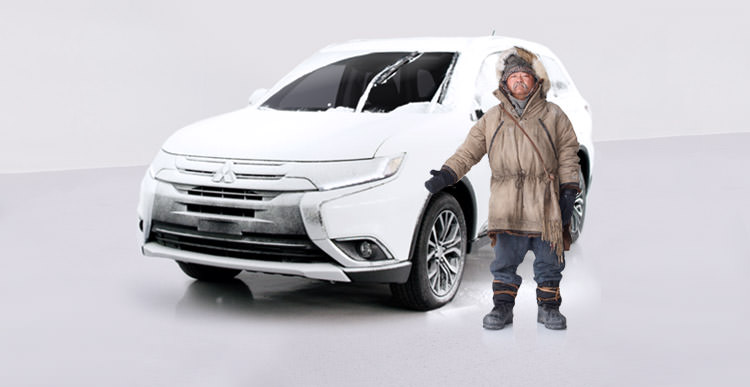 2016 Mitsubishi Outlander CUV windshield wiper de-icers covered in ice