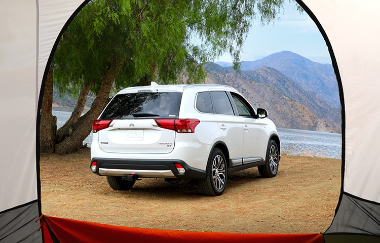 View of 2018 White Mitsubishi Crossover from Tent