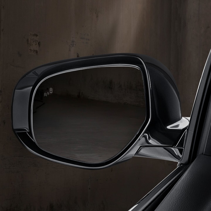 Change lanes with confidence using Blind Spot Warning<VLP005> alerts in the side view mirrors.