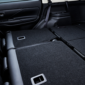 Close up of the rear seats folded down inside a 2020 Mitsubishi Outlander SUV.