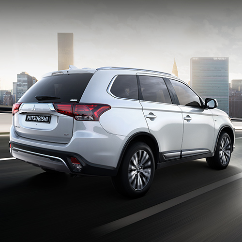 Back view of a while 2020 Mitsubishi Outlander crossover SUV exterior