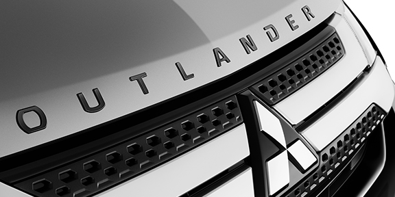 Close up shot of 2020 Mitsubishi Outlander front grill and brand logo