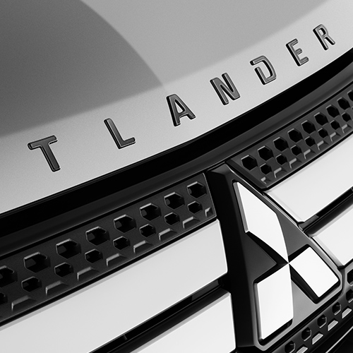 Close up of the front grill and badge on a 2020 Mitsubishi Outlander SUV.