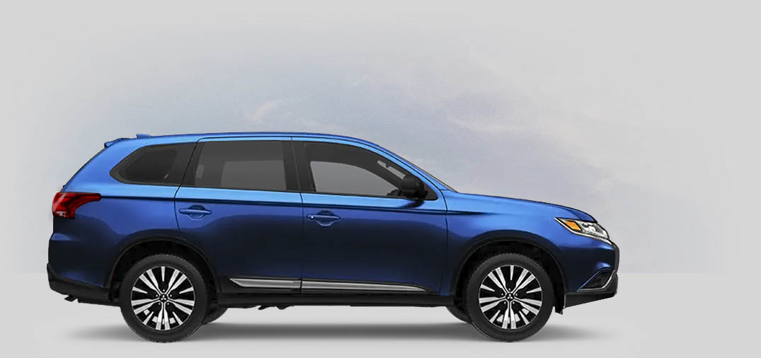 A 2020 Mitsubishi Outlander ES 2.4 with cosmic blue metallic color.