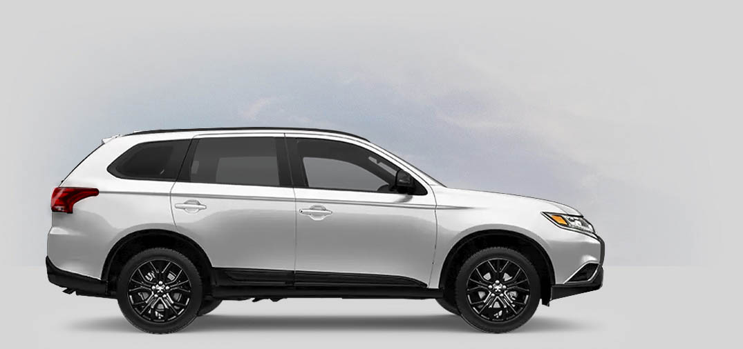 A 2020 Mitsubishi Outlander LE 2.4 with pearl white color.