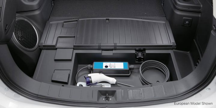 Conveniently store and access Outlander PHEV's charging cables in the dedicated storage compartment.