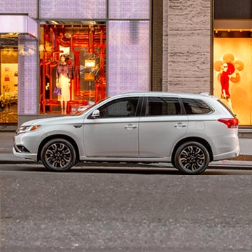 Meet the all-new Outlander Plug-In Hybrid SUV featuring Mitsubishi's newly redesigned grille.
