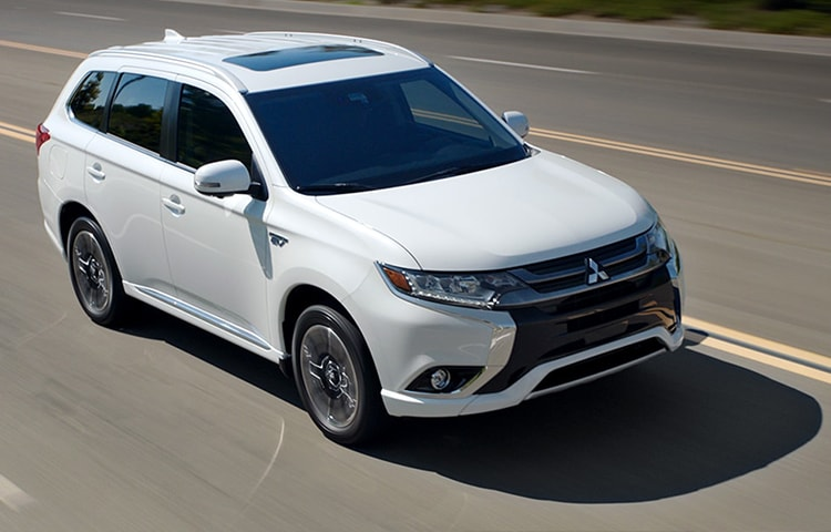 Front view of a white 2018 Mitsubishi Outlander PHEV SUV on the road