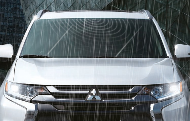 Front view of a Mitsubishi Outlander PHEV demonstrating rain sensing windshield wipers