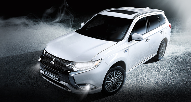 Overview of white 2019 Mitsubishi Outlander PHEV on road