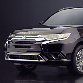 Front side view of a 2019 Mitsubishi Outlander PHEV in black.