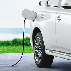 Side view of the DC fast charger plugged in the 2019 Mitsubishi Outlander PHEV SUV.